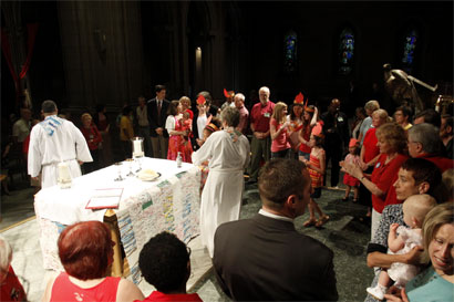 Photo: Communion at the 9:00 Mostly Jazz Mass