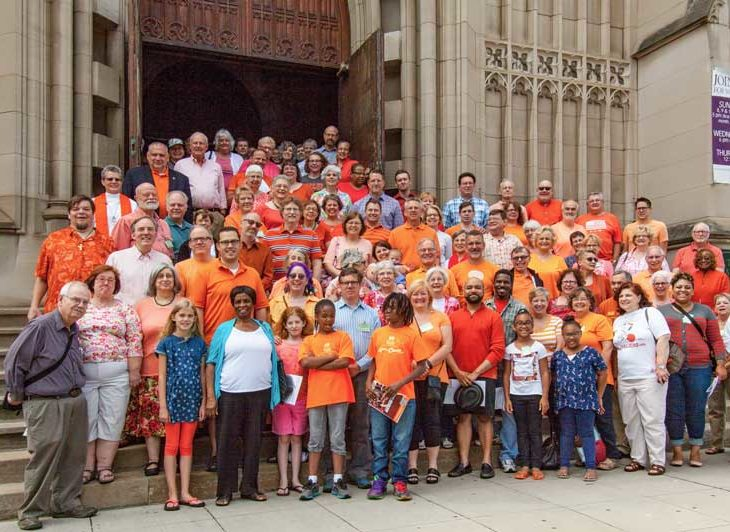 Image Trinity Congregation wearing orange